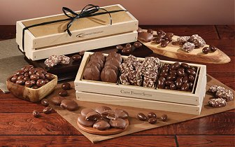 Wooden Collectors boxes and wooden crates filled with chocolates, nuts and toffee